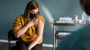 COVID efecte secundare femei
